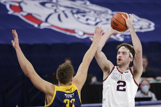 Gonzaga forward Drew Timme (2) shoots over Northern Arizona forward Carson Towt (33) during the second half of an NCAA college basketball game in Spokane, Wash., Monday, Dec. 28, 2020. Gonzaga won 88-58. (AP Photo/Young Kwak)