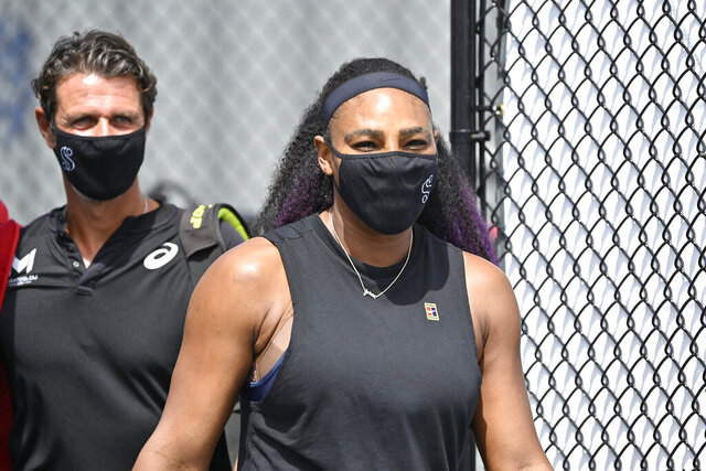 Serendipities Williams arrives at center court wearing a mask before the start of her match against Shelby Rogers at the WTA tennis tournament in Nicholasville, Ky., Friday, Aug. 14, 2020. (AP Photo/Timothy D. Easley)