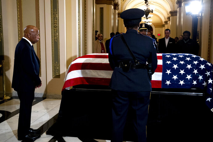 Rep. John Lewis, D-Ga. pays his respects to Rep. Elija­h Cummi­ngs, D-Md., as Cummings lies in state outside of the House Chamber in the Will Rogers corridor of the U.S. Capitol in Washington, Thursday, Oct. 24, 2019. (Anna Moneymaker/Pool via AP)