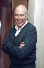 "FILE - In this Oct. 15, 1993 file photo, writer-comedian and film director Carl Reiner, 71, appears after an interview in New York. Reiner, the ingenious and versatile writer, actor and director who broke through as a ""second banana"" to Sid Caesar and rose to comedy's front ranks as creator of ""The Dick Van Dyke Show"" and straight man to Mel Brooks' ""2000 Year Old Man,"" has died, according to reports. Variety reported he died of natural causes on Monday night, June 29, 2020, at his home in Beverly Hills, Calif. He was 98. (AP Photo/Crystyna Czajkowsky, File)"