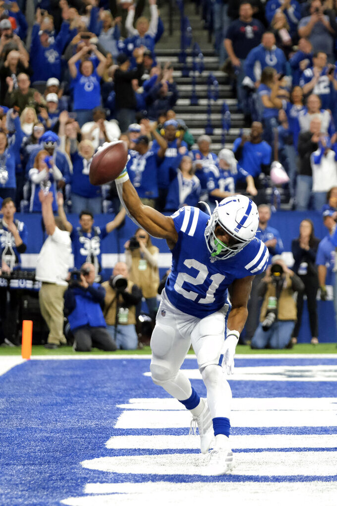 Indianapolis Colts' Nyheim Hines (21) celebrates a touchdown during the second half of an NFL football game against the Jacksonville Jaguars, Sunday, Nov. 17, 2019, in Indianapolis. (AP Photo/AJ Mast)
