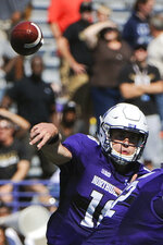 "FILE - In this Sept. 3, 2016, file photo, Northwestern quarterback Aidan Smith throws a pass during the first quarter of an NCAA college football game against Western Michigan in Evanston, Ill. As he listened to his team's introduction during last month's Big Ten Kickoff Luncheon, Northwestern coach Pat Fitzgerald was a bit stunned by what he heard.  ""Clayton Thorson leaves as the winningest quarterback in Northwestern history,"" the Big Ten Network's Rick Pizzo said, reading from a script. ""But he'll be replaced by five-star Clemson transfer Hunter Johnson.""  That was news to Fitzgerald, who said the competition for starting quarterback at the beginning of fall camp was wide open with Hunter, senior TJ Green and junior Aidan Smith being the main contenders. (AP Photo/Matt Marton, File)"