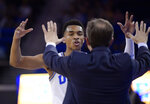 UCLA guard Jaylen Hands, left, celebrates with interim coach Murry Bartow in the closing seconds of the team's NCAA college basketball game against Arizona on Saturday, Jan. 26, 2019, in Los Angeles. UCLA won 90-69. (AP Photo/Mark J. Terrill)