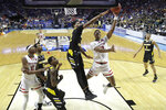 Texas Tech's Jarrett Culver puts up a shot under pressure from Northern Kentucky's Dantez Walton during the second half of a first round men's college basketball game in the NCAA Tournament Friday, March 22, 2019, in Tulsa, Okla. Texas Tech won 72-57. (AP Photo/Charlie Riedel)