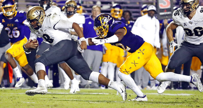 Central Florida quarterback Darriel Mack Jr. (8) tries to get away from East Carolina's Devon Sutton (42) during the first half of an NCAA college football game in Greenville, N.C., Saturday, Oct. 20, 2018. (AP Photo/Karl B DeBlaker)