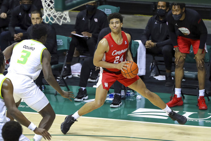 Houston's Quentin Grimes steps out to shoot against South Florida's Prince Oduro during the second half of an NCAA college basketball game Wednesday, Feb. 10, 2021, in Tampa, Fla. Houston won 82-65. (AP Photo/Mike Carlson)
