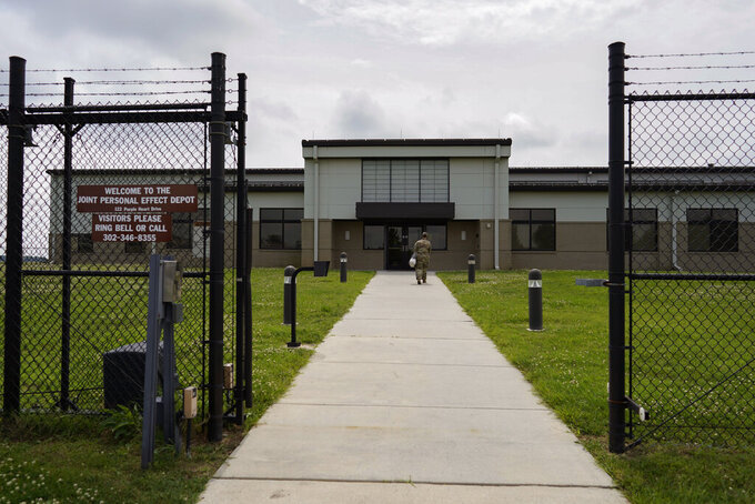 A gate surrounds the Joint Personal Effects Depot on Dover Air Force Base, Del., Monday, June 21, 2021. The depot is where the personal effects of deceased service members are processed as part of dignified transfers. (AP Photo/Carolyn Kaster)