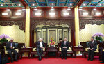 Iranian Foreign Minister Mohammad Javad Zarif, center left, and his Chinese counterpart Wang Yi, center right, during their meeting at the Diaoyutai State Guesthouse in Beijing, China, Tuesday, Feb. 19, 2019. The foreign ministers of China and Iran met in Beijing on Tuesday amid efforts to preserve the 2015 nuclear deal with Tehran.(How Hwee Young/Pool Photo via AP)
