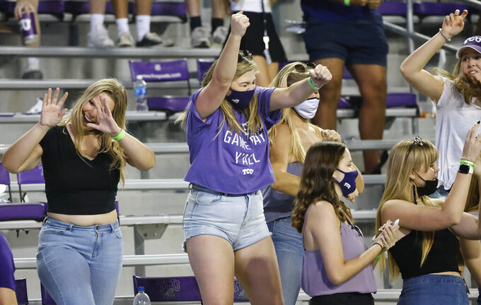 TCU fans react following a score against Texas Tech during the second half of an NCAA college football game Saturday, Nov. 7, 2020, in Fort Worth, Texas. (AP Photo/Ron Jenkins)