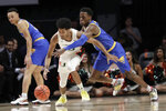 Pittsburgh guard Xavier Johnson, right, defends against Miami guard Harlond Beverly during the first half of an NCAA college basketball game, Sunday, Jan. 12, 2020, in Coral Gables, Fla. (AP Photo/Lynne Sladky)