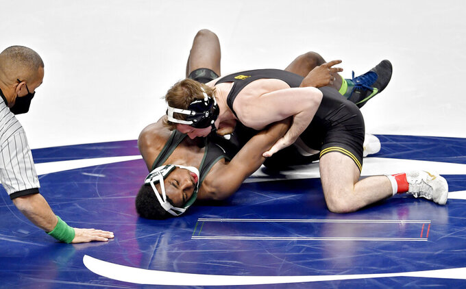 Iowa's Spencer Lee controls Michigan State's Rayvon Foley in a 125 lb semi-final bout of the 2021 Big Ten Wrestling Tournament at the Bryce Jordan Center in State College, Pa, on Saturday, March 6, 2021. (Abby Drey/Centre Daily Times via AP)