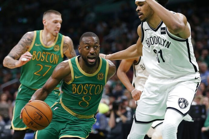 Boston Celtics' Kemba Walker (8) drives past Brooklyn Nets' Jarrett Allen (31) during the second half of an NBA basketball game in Boston, Wednesday, Nov. 27, 2019. (AP Photo/Michael Dwyer)