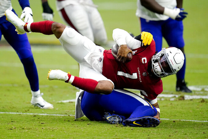 Arizona Cardinals quarterback Kyler Murray (1) is tackled by Minnesota Vikings defensive end Danielle Hunter during the second half of an NFL football game, Sunday, Sept. 19, 2021, in Glendale, Ariz. (AP Photo/Ross D. Franklin)