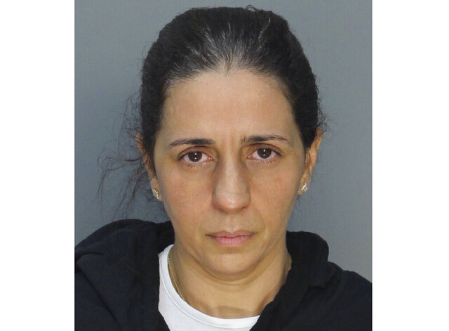 This photo provided by Miami-Dade Corrections and Rehabilitation shows Patricia Ripley.  Officials say Ripley faked her son's abduction and instead led him to the canal where he drowned. Court records show 45-year-old Patricia Ripley is facing a first-degree murder charge. Her son was 9-year-old Alejandro Ripley and was autistic.  The boy's body was found early Friday, May 22, 2020 at a golf course canal. (Miami-Dade Corrections and Rehabilitation via AP)