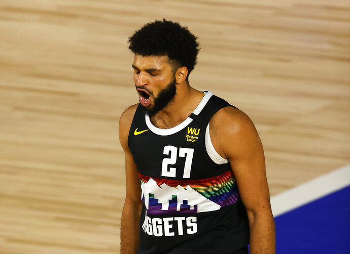 Jamal Murray of the Denver Nuggets reacts after a shot during the second half of Game 5 of an NBA basketball first-round playoff series, Tuesday, Aug. 25, 2020, in Lake Buena Vista, Fla. (Mike Ehrmann/Pool Photo via AP)