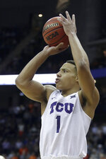 TCU's Desmond Bane puts up a 3-point shot during the second half of the team's NCAA college basketball game against Oklahoma State in the Big 12 men's tournament Wednesday, March 13, 2019, in Kansas City, Mo. against TCU won 73-70. (AP Photo/Charlie Riedel)