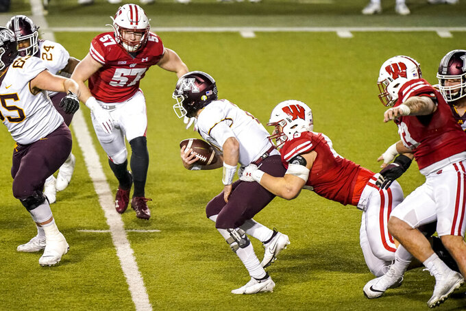 Wisconsin linebacker Leo Chenal (45) sacks Minnesota quarterback Tanner Morgan during the second half of an NCAA college football game Saturday, Dec. 19, 2020, in Madison, Wis. (AP Photo/Andy Manis)