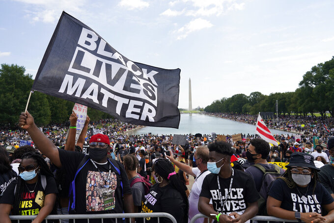 """People attend the March on Washington, Friday Aug. 28, 2020, in Washington, on the 57th anniversary of the Rev. Martin Luther King Jr.'s """"I Have A Dream"""" speech. (AP Photo/Carolyn Kaster)"""