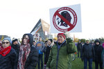 FILE - In this Oct. 24, 2019, file photo, Native American leaders protest against the Redskins team name outside U.S. Bank Stadium before an NFL football game between the Minnesota Vikings and the Washington Redskins in Minneapolis. Several Native American leaders and organizations have sent a letter to NFL Commissioner Roger Goodell calling for the league to force Washington Redskins owner Dan Snyder to change the team name immediately.  (AP Photo/Bruce Kluckhohn, File)