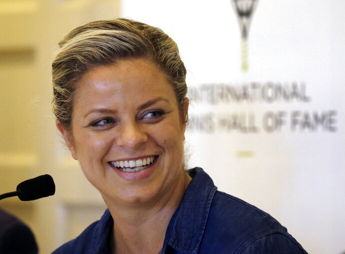 FILE - In this July 22, 2017, file photo, tennis Hall of Fame inductee Kim Clijsters of Belgium smiles during a news conference before enshrinement ceremonies at the International Tennis Hall of Fame in Newport, R.I. Clijsters is scheduled to compete in the U.S. Open tennis tournament, scheduled to run Aug. 31-Sept. 13, 2020. (AP Photo/Elise Amendola, File)