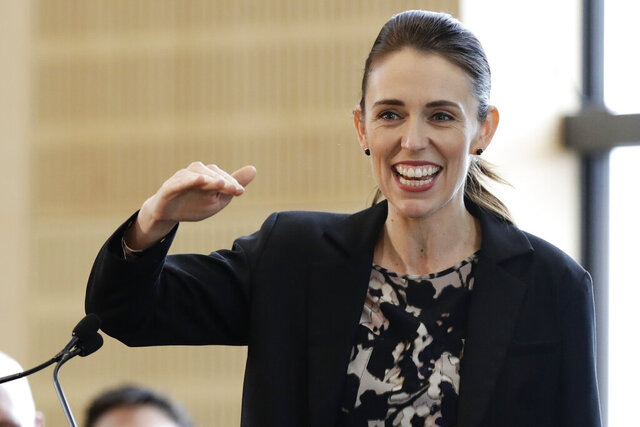 FILE - In this June 25, 2020, file photo, New Zealand Prime Minister Jacinda Ardern gestures during the opening ceremony for Redcliffs School in Christchurch, New Zealand. A new opinion poll indicates that Ardern is poised to win a second term in office when the nation goes to the polls next month. But Ardern said Tuesday, Sept. 22, 2020, that she's taking nothing for granted. (AP Photo/Mark Baker)