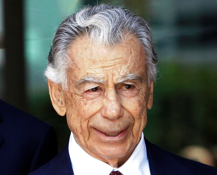 FILE - In this Aug. 20, 2008 file photo, billionaire Kirk Kerkorian leaves the Roybal Federal Building in Los Angeles. The medical school of the University of Nevada, Las Vegas, received a secret donation of $25 million from Kerkorian, a Las Vegas casino builder and movie studio owner,  following his death in 2015, the Las Vegas Review-Journal reported Tuesday, April 30, 2019. The Kerkorian estate executor was upset to learn of the disclosure but declined to say whether the estate would demand that the money be returned. (AP Photo/Nick Ut, File)