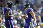 Baltimore Ravens tight end Mark Andrews, right, celebrates his touchdown catch on a pass from quarterback Lamar Jackson, not visible, with inside linebacker Patrick Onwuasor during the second half of an NFL football game against the Cleveland Browns Sunday, Sept. 29, 2019, in Baltimore. (AP Photo/Gail Burton)