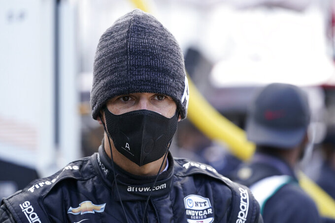 Helio Castroneves, of Brazil, waits in the pits during a practice session for the IndyCar auto race at Indianapolis Motor Speedway, Thursday, Oct. 1, 2020, in Indianapolis. (AP Photo/Darron Cummings)