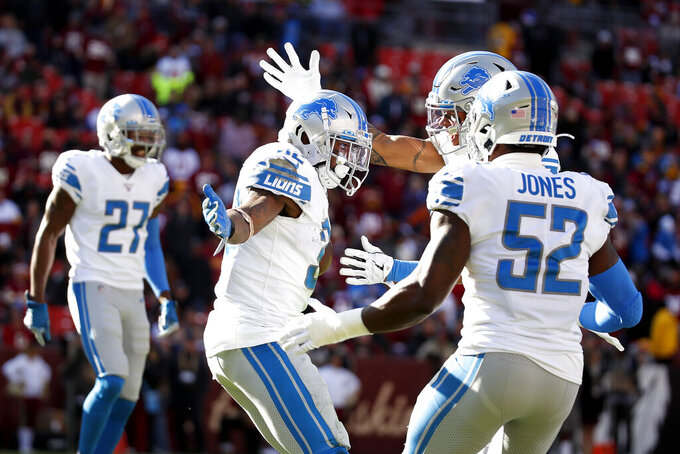 Detroit Lions strong safety Tavon Wilson, center, celebrates with teammates after recovering a fumble by Washington Redskins quarterback Dwayne Haskins, not visible, during the first half of an NFL football game, Sunday, Nov. 24, 2019, in Landover, Md. (AP Photo/Alex Brandon)
