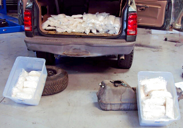 This Friday, Jan. 10, 2020 photo released by U.S. Customs and Border Protection shows some of more than $190,000 worth of methamphetamine concealed in a vehicle along a Southern California highway, the agency said in a statement Monday, Jan. 13, 2020. An agent patrolling Interstate 15 followed a suspicious vehicle Friday as it exited onto U.S. 395 and parked at a gas station in the unincorporated Rainbow area of San Diego County south of Temecula, the agency said. A search dog alerted to the vehicle as the agent spoke to the driver and a detailed inspection found more than 100 pounds (45.3 kilograms) of meth in 96 packages inside the gas tank, spare tire and quarter panels of the Ford Explorer, the Border Patrol said. The driver, only identified as a 34-year-old U.S. citizen, was arrested. (U.S. Customs and Border Protection via AP)