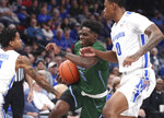 Tulane guard Teshaun Hightower (5) breaks through the defense of Memphis forward D.J. Jeffries (0) in the first half of an NCAA college basketball game Monday, Dec. 30, 2019, in Memphis, Tenn. (AP Photo/Karen Pulfer Focht)