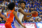 Kentucky's Ashton Hagans, right, looks for an opening on Florida's Ques Glover, left, in the first half of an NCAA college basketball game in Lexington, Ky., Saturday, Feb. 22, 2020. (AP Photo/James Crisp)