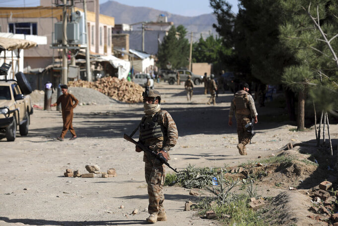 Afghan security personnel arrive at the site of a bomb explosion in Shakar Dara district of Kabul, Afghanistan, Friday, May 14, 2021. A bomb ripped through a mosque in northern Kabul during Friday prayers killing 12 worshippers, Afghan police said. (AP Photo/Rahmat Gul)