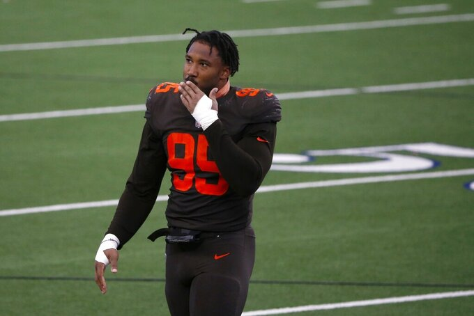 Cleveland Browns defensive end Myles Garrett (95) blows a kiss to fans after their 49-38 win against the Dallas Cowboys in an NFL football game in Arlington, Texas, Sunday, Oct. 4, 2020. (AP Photo/Michael Ainsworth)