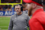 FILE - In this Dec. 31, 2019, file photo, Utah head coach Kyle Whittingham walks the sideline during the first half of the Alamo Bowl NCAA college football game against Texas in San Antonio. Whittingham was not all that surprised when his team was picked to finish third in the south division during the preseason Pac-12 media poll. (AP Photo/Eric Gay, File)