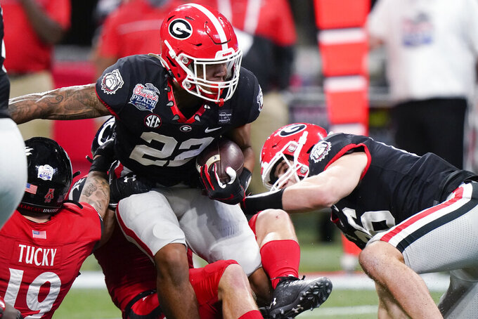 Georgia running back Kendall Milton (22) runs against Cincinnati during the first half of the Peach Bowl NCAA college football game, Friday, Jan. 1, 2021, in Atlanta. (AP Photo/Brynn Anderson)