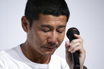 Zozo founder, Yusaku Maezawa, gets teary-eyed during a news conference Thursday, Sept. 12, 2019, in Tokyo. Yahoo Japan Corp. said Thursday it will put up a tender offer, estimated at 400 billion yen ($3.7 billion), for Zozo Inc., a Japanese online retailer started by a celebrity tycoon. (AP Photo/Jae C. Hong)
