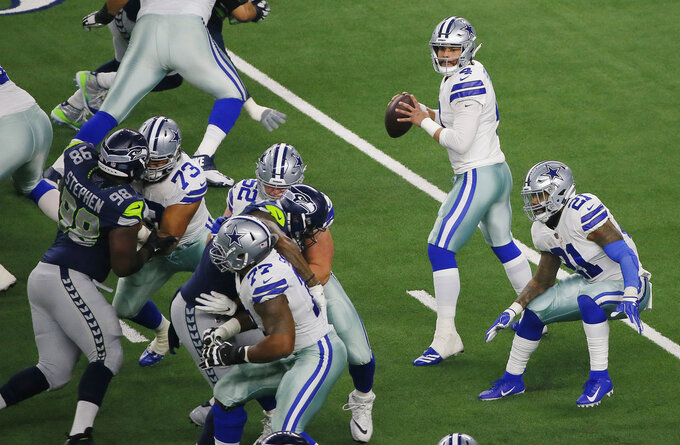 Dallas Cowboys quarterback Dak Prescott (4) works in the pocket against the Seattle Seahawks during the first half of the NFC wild-card NFL football game in Arlington, Texas, Saturday, Jan. 5, 2019. (AP Photo/Roger Steinman)