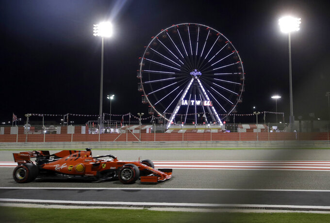 Ferrari driver Sebastian Vettel of Germany steers his car during the second free practice at the Formula One Bahrain International Circuit in Sakhir, Bahrain, Friday, March 29, 2019. The Bahrain Formula One Grand Prix will take place on Sunday. (AP Photo/Luca Bruno)