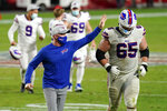 Buffalo Bills head coach Sean McDermott congratulates offensive guard Ike Boettger (65) after an NFL football game against the San Francisco 49ers, Monday, Dec. 7, 2020, in Glendale, Ariz. The Bills won 34-24. (AP Photo/Ross D. Franklin)