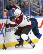 Colorado Avalanche's Pierre-Edouard Bellemare (41), of France, handles the puck in front of St. Louis Blues' Robert Thomas (18) during the second period of an NHL hockey game Monday, Oct. 21, 2019, in St. Louis. (AP Photo/Scott Kane)