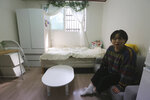 "Kim Da-hye, a 29-year-old South Korean, sits in her semi-basement apartment in Seoul, South Korea, Saturday, Feb. 15, 2020. For many South Koreans, the image of a cramped basement apartment portrayed in the Oscar-winning film ""Parasite"" rings true, bringing differences in their social status to worldwide attention.(AP Photo/Ahn Young-joon)"