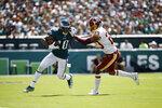 Philadelphia Eagles' DeSean Jackson, left, tries to break free of Washington Redskins' Quinton Dunbar during the first half of an NFL football game, Sunday, Sept. 8, 2019, in Philadelphia. (AP Photo/Matt Rourke)