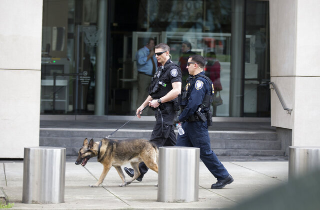 FILE - In this Jan. 27, 2016, file photo, multiple security details are seen outside of the Mark O. Hatfield U.S. Courthouse in Portland, Ore. A Portland area man accused by federal authorities of helping Islamic State extremists maintain a