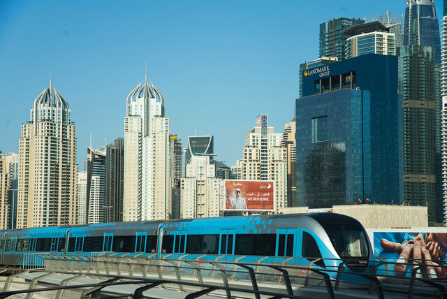 FILE - In this April 26, 2020 file photo, the driverless Metro passes the Dubai Marina  in Dubai, United Arab Emirate. For eager Israelis, anticipation is mounting that Dubai's glitzy Burj Khalifa, will soon join the ranks of the Pyramids in Egypt and relics of the ancient Nabatean Kingdom of Petra in Jordan as an iconic landmark that was once unattainable but is now within reach. Last week's dramatic announcement making the UAE just the third Arab nation to establish full diplomatic ties with Israel has set off a flurry of excitement. (AP Photo/Jon Gambrell, File)