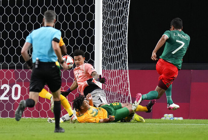 Mexico's Luis Romo, right, scores his teams second goal against South Africa during a men's soccer match at the 2020 Summer Olympics, Wednesday, July 28, 2021, in Sapporo, Japan. (AP Photo/Silvia Izquierdo)