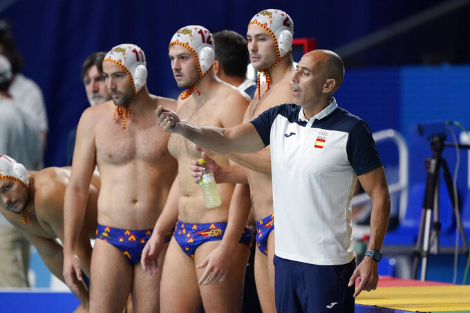 Spain's head coach David Martin Lozano directs his players during a preliminary round men's water polo match against Kazakhstan at the 2020 Summer Olympics, Thursday, July 29, 2021, in Tokyo, Japan. (AP Photo/Mark Humphrey)