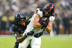 Oregon State tight end Teagan Quitoriano (84) is tackled by Purdue cornerback Cory Trice (23) after a catch during the first half of an NCAA college football game in West Lafayette, Ind., Saturday, Sept. 4, 2021. (AP Photo/Michael Conroy)