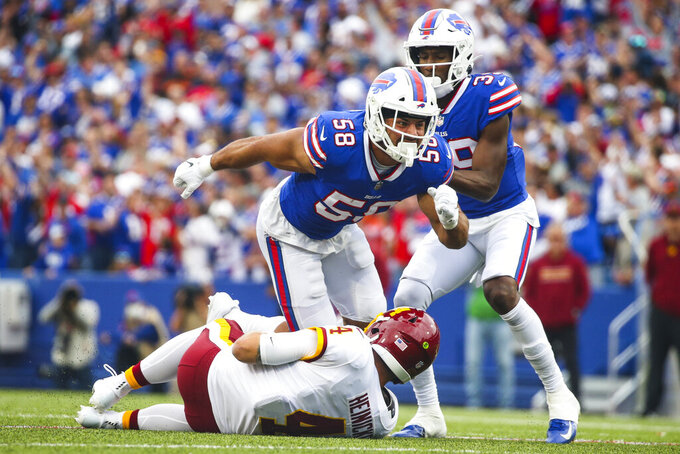 Buffalo Bills' Matt Milano (58) and Levi Wallace (39) celebrate after Milano sacked Washington Football Team quarterback Taylor Heinicke (4) during the second half of an NFL football game Sunday, Sept. 26, 2021, in Orchard Park, N.Y. (AP Photo/Jeffrey T. Barnes)