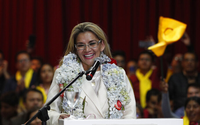 Bolivia's interim President Jeanine Anez smile during a ceremony announce her nomination as presidential candidate for the May 3 elections in La Paz, Bolivia, Friday, Jan. 24, 2020. (AP Photo/Juan Karita)